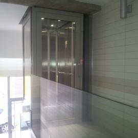 Ascensor a cota 0 y elevador